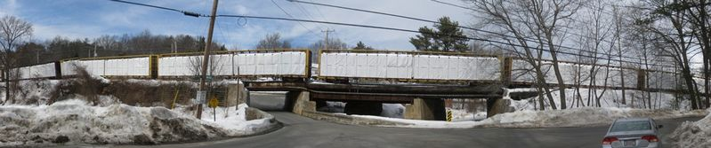 Pan Am Railway Railcars Parked on Bridge Over Bridge Street