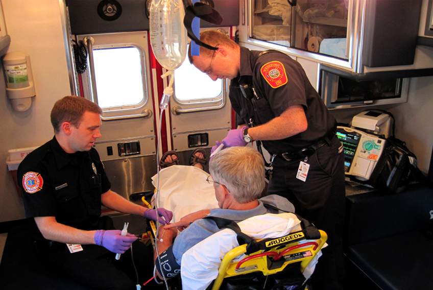 EMS Technicians Care for a Patient in the Ambulance