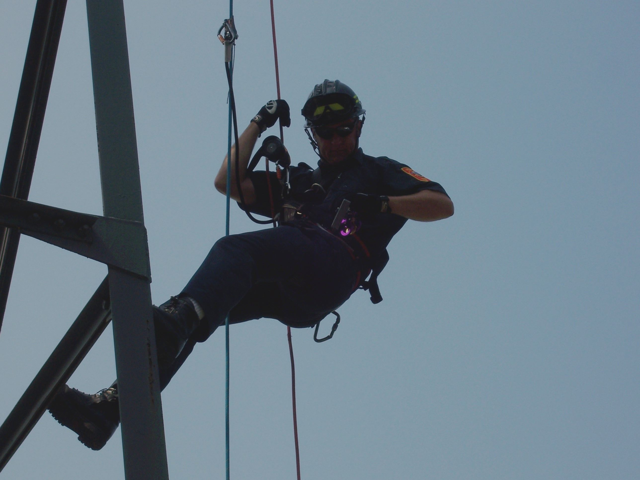 Firefighter Trains Repelling on a Rig